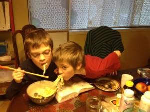 Boys eating pasta